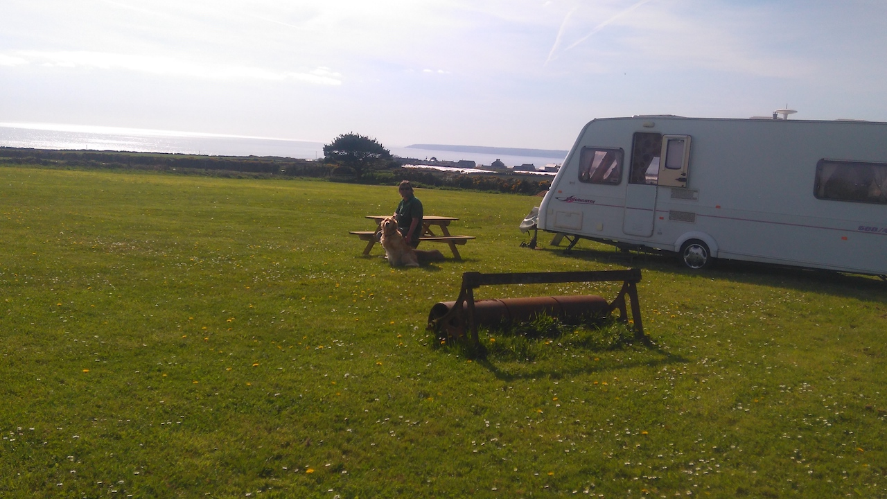 Caravan parked at Sea View Camping at Dropped Anchor