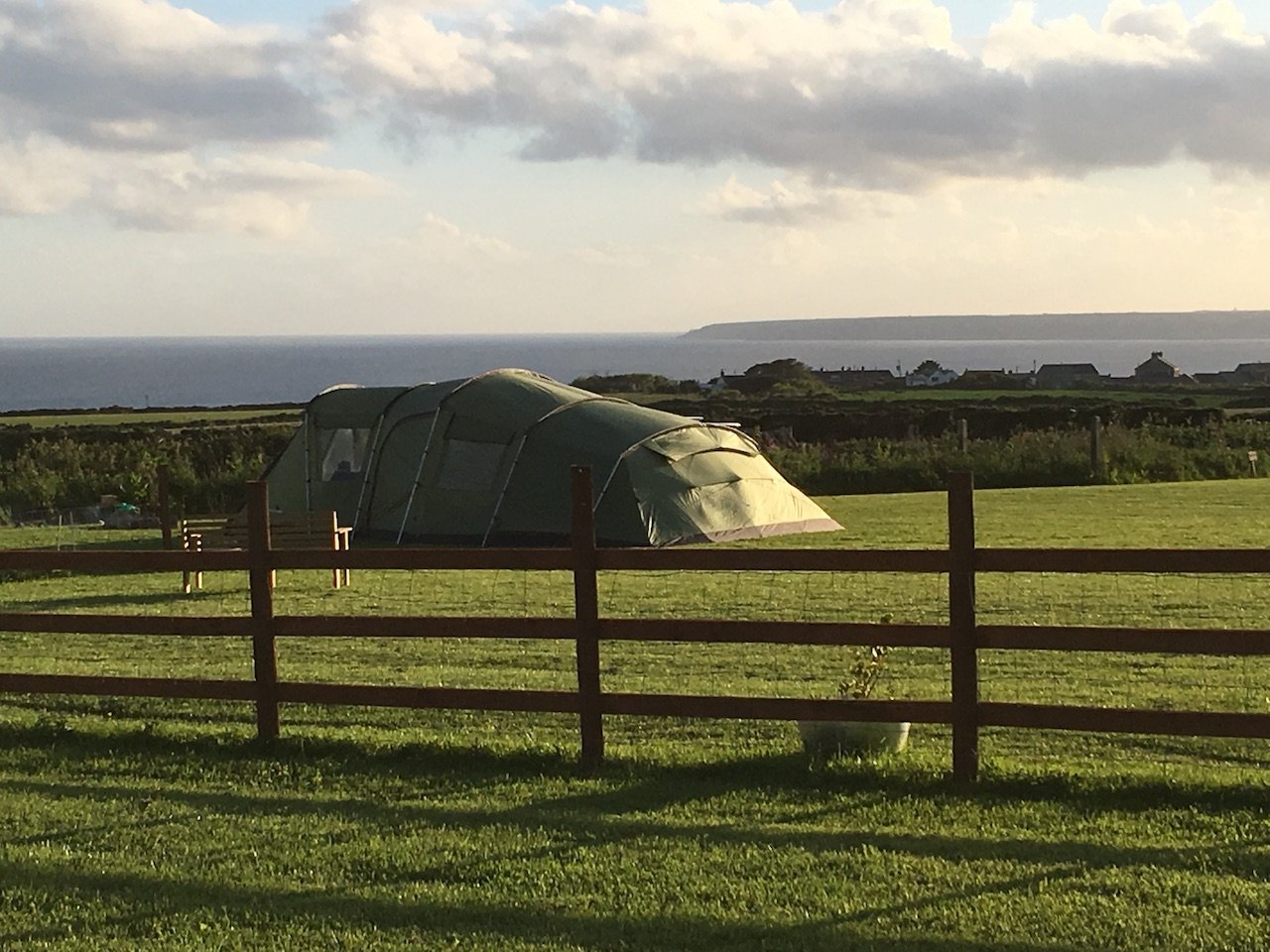 Green tent on campsite